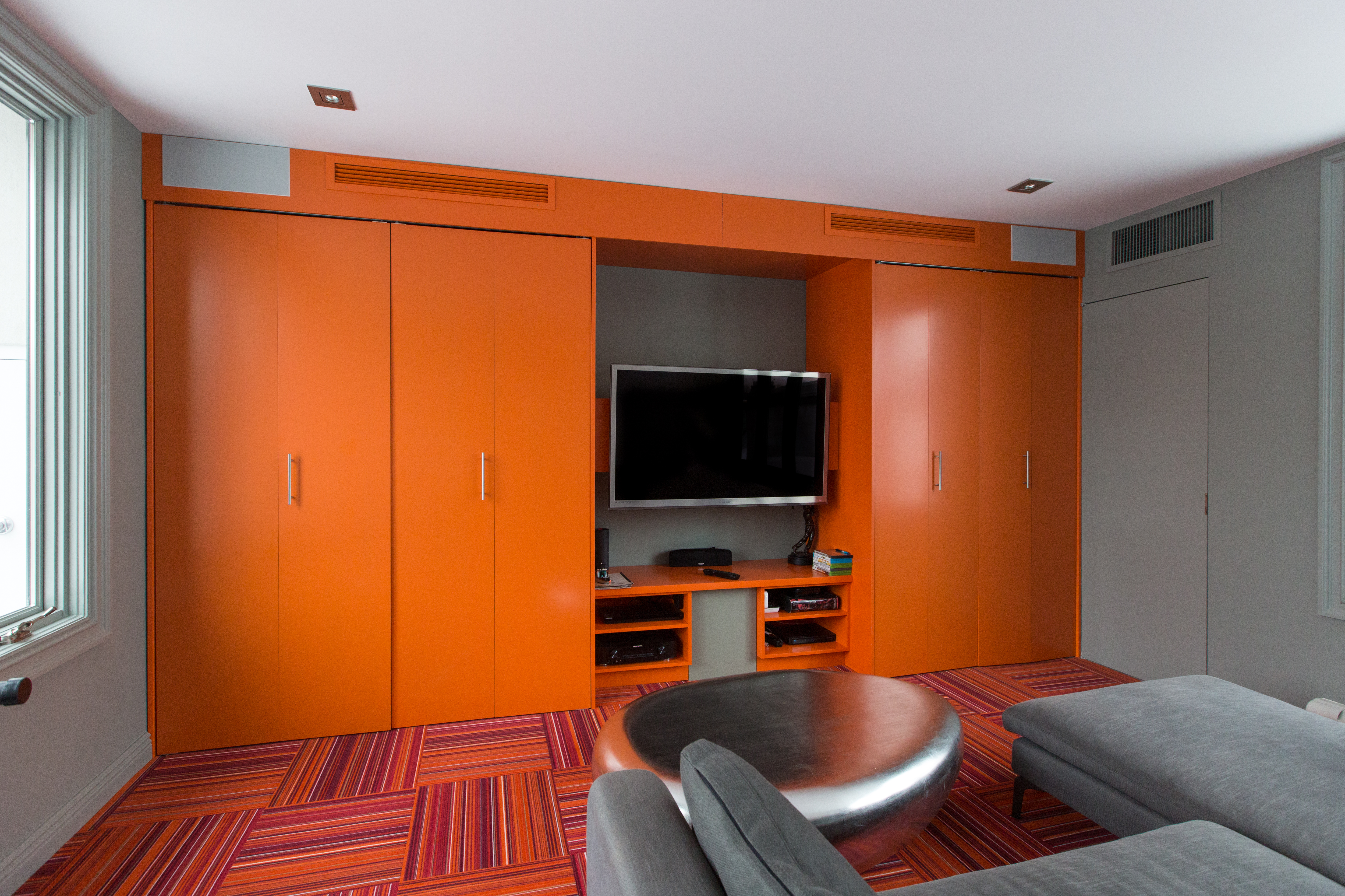 At the top left and right of the cabinet you can see the two high-end Polk 265-LS in-wall speakers we installed for the audio system