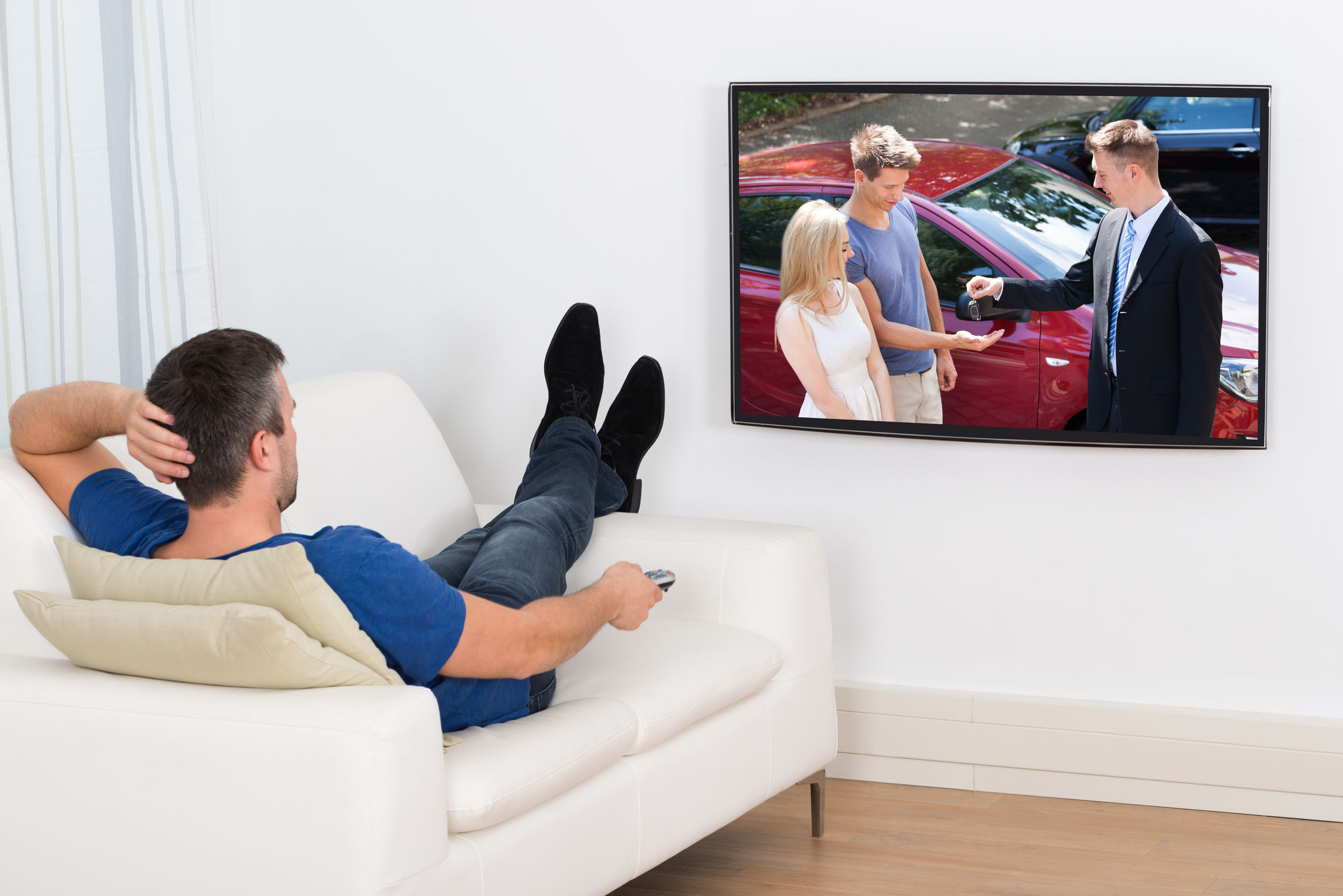 customer is watching HDTV in his living room
