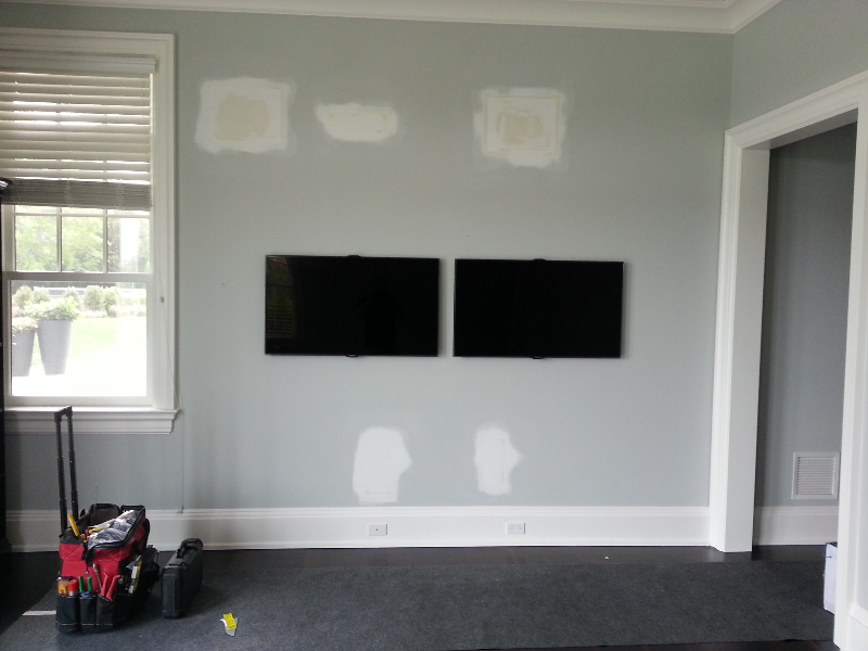 Double Tv Screens mounted on the wall with five invisible speakers surround.