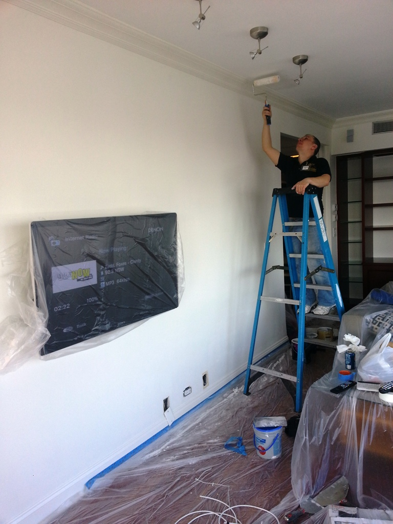 dtv installer patching up the ceiling