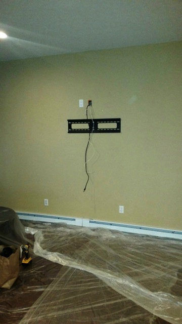 DTV protects custoemrs floor while installing Home Theatre System. Hauppauge (Suffolk County), NY 1.jpg