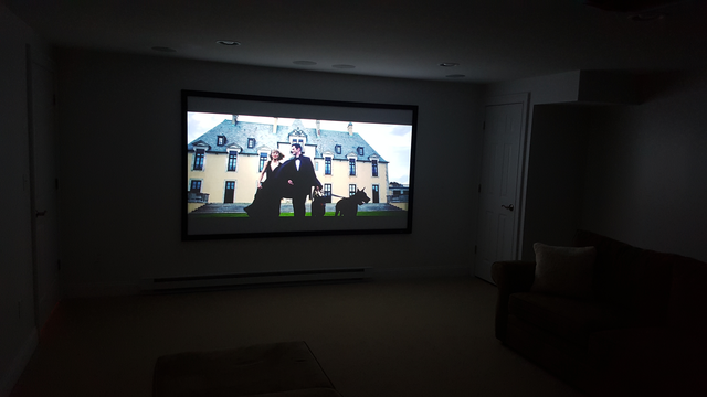 home theater projector in dark room