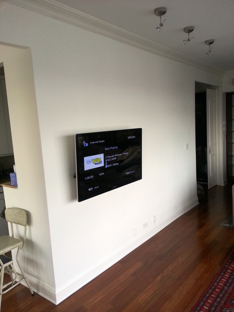 SAMSUNG UN55HU8550 55 Ultra Thin Smart TV hangin on the wall