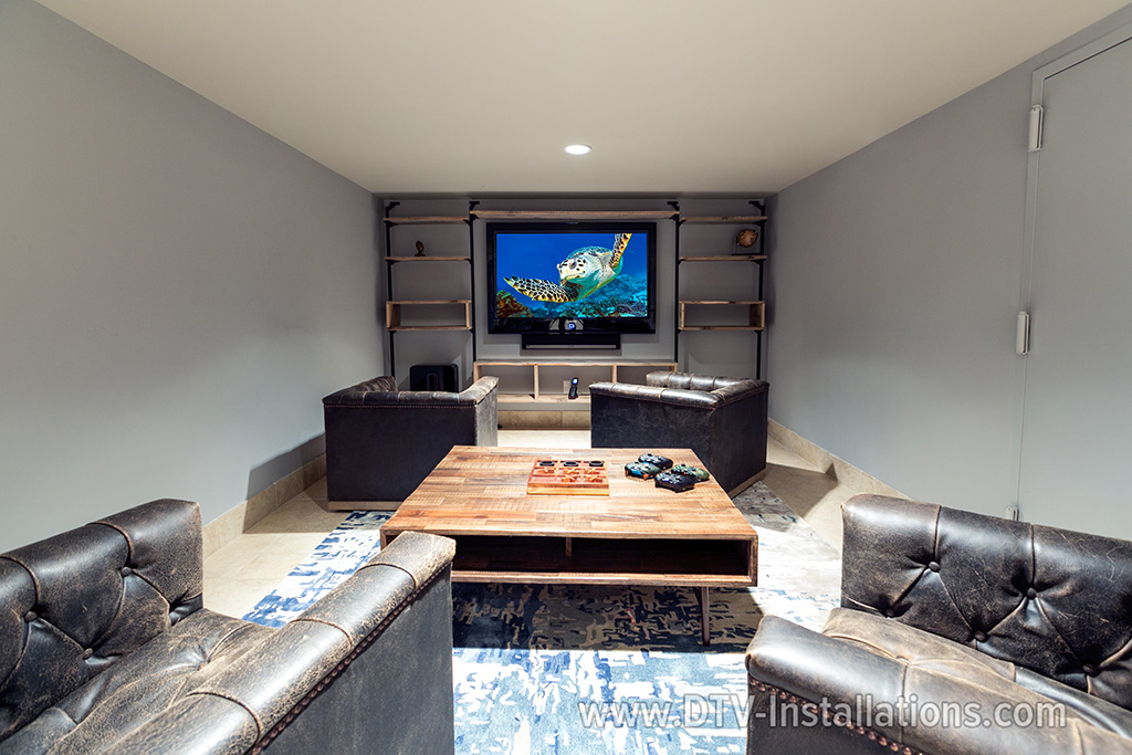 Sonos-sound-playbar-mounted-on-the-wall-under-tv-in-media-room,-Scarsdale,-NY