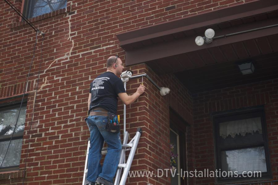 DTV contractor working on ladder in Brooklyn NY