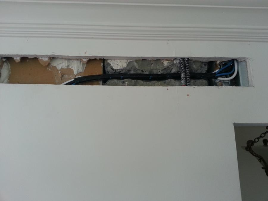 smart tv mounted on the wall manhattan ny lower east side example of hidden wiring
