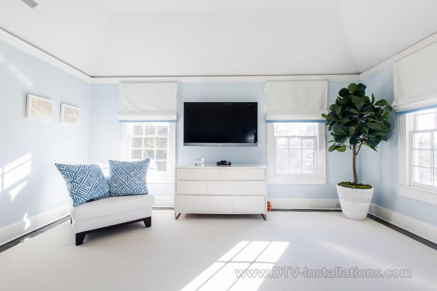 Flatscreen HDTV monitor over the bedroom dresser
