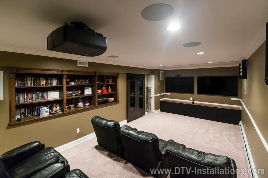 Sony VPL-VW665EX home theater projector mounted on a ceiling in a media room