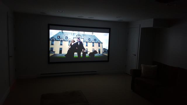 home theater projector in dark room
