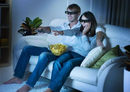 Happy Family watching 3d tv streaming at home