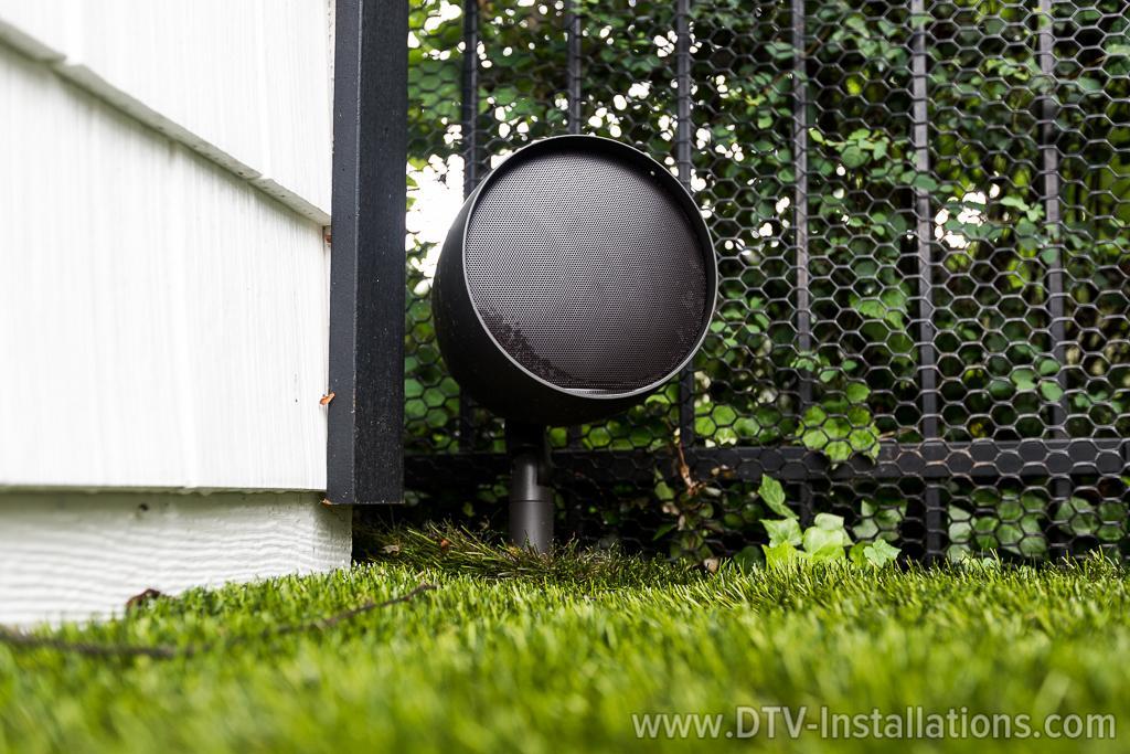 Episode® Landscape Series Satellite Speaker on the New Yorker's backyard