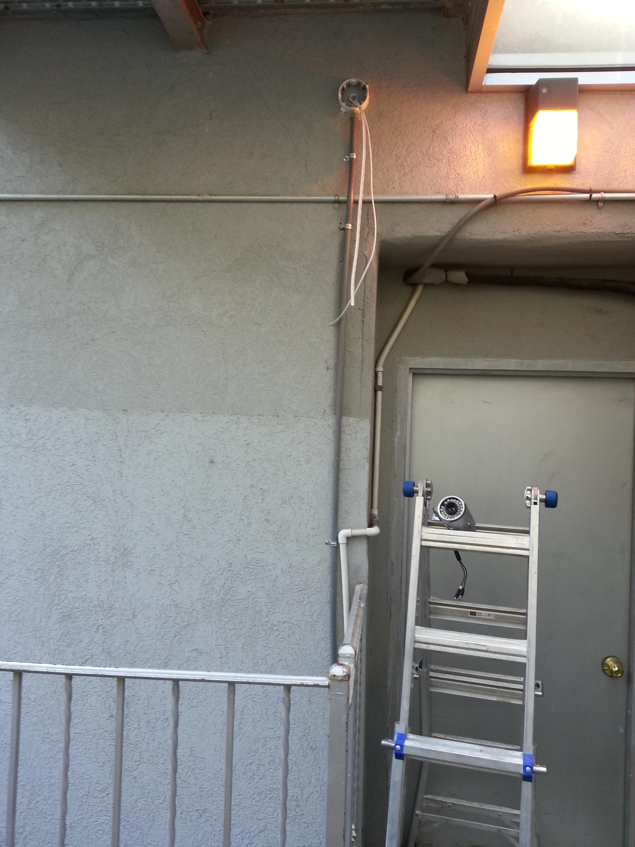 Process of installation security cameraat residential building of Upper West Side in Manhattan, NY