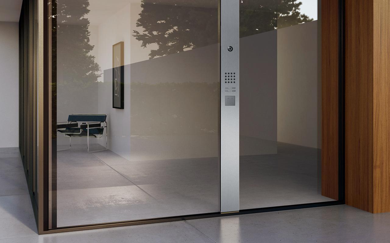 Siedle Steel Panel intercom mounted on the glass wall