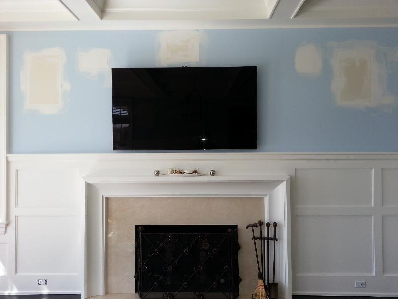 TVs Mounted Over Fireplace in process 2.jpg