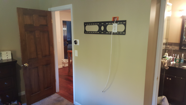 TV braket and electrical outlet behind the area where the TV would be placed