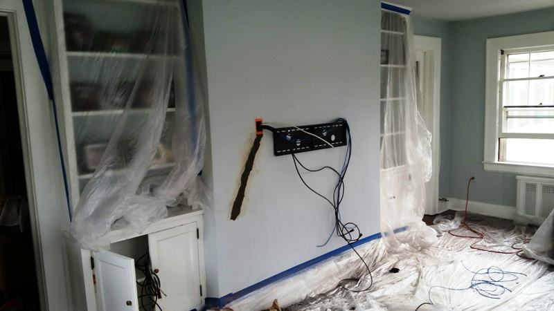 TV mounted on the concrete wall 2.jpg