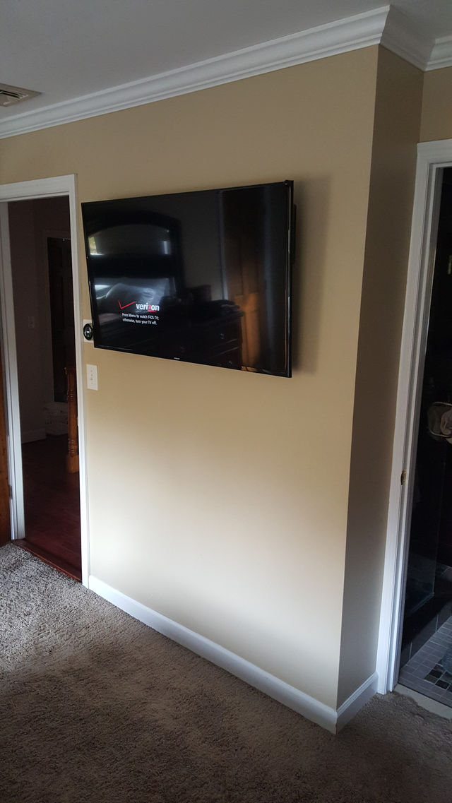TV mounted on the wall 2