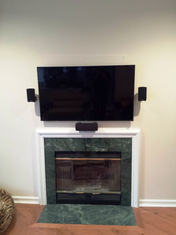 TV over fireplacve with 5.1 Home Theater Sound System.jpg