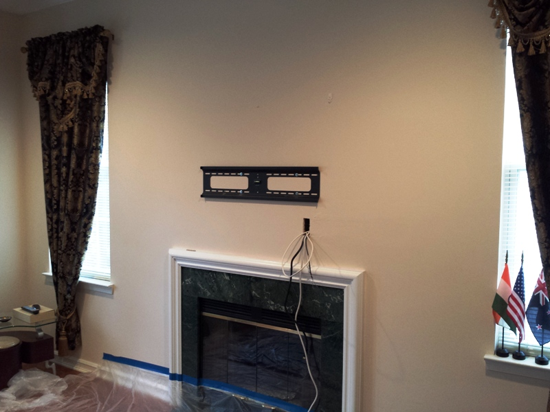 TV over the fireplace.jpg