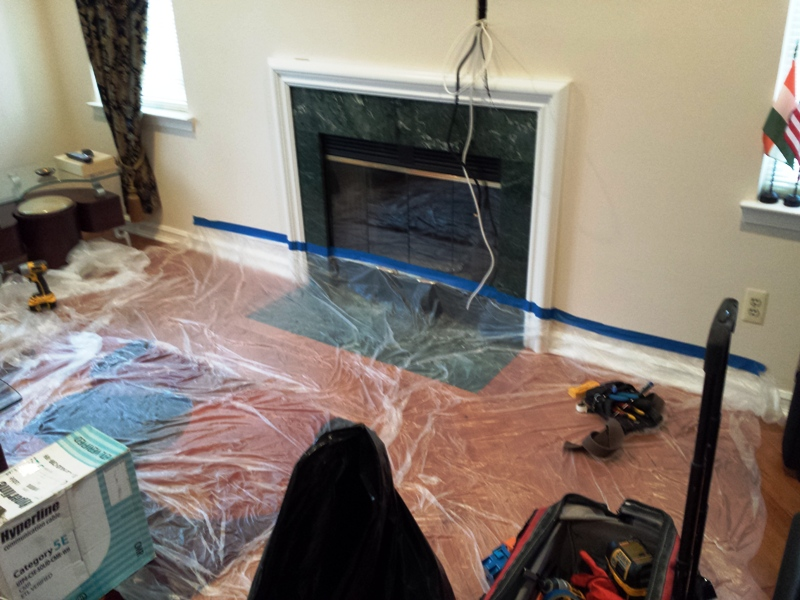 TV over the fireplace preparation.jpg