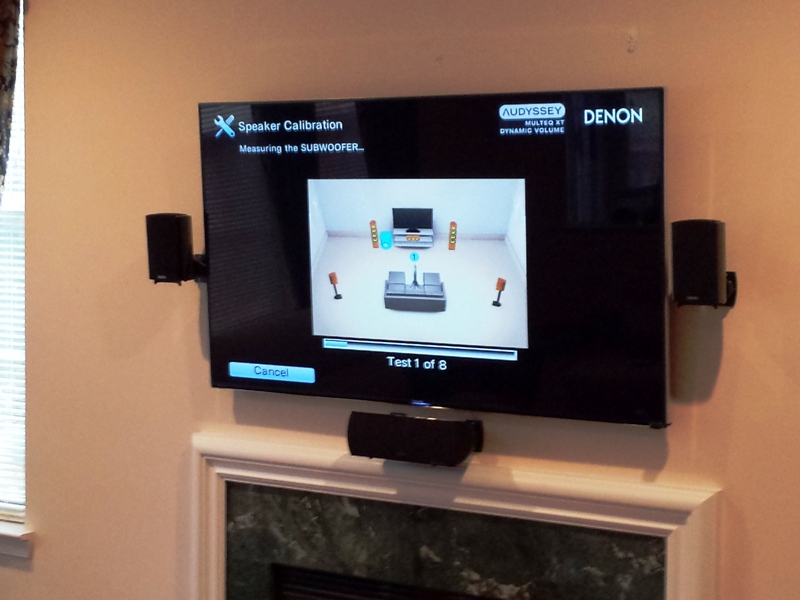 TV over the fireplace with speakers set.jpg