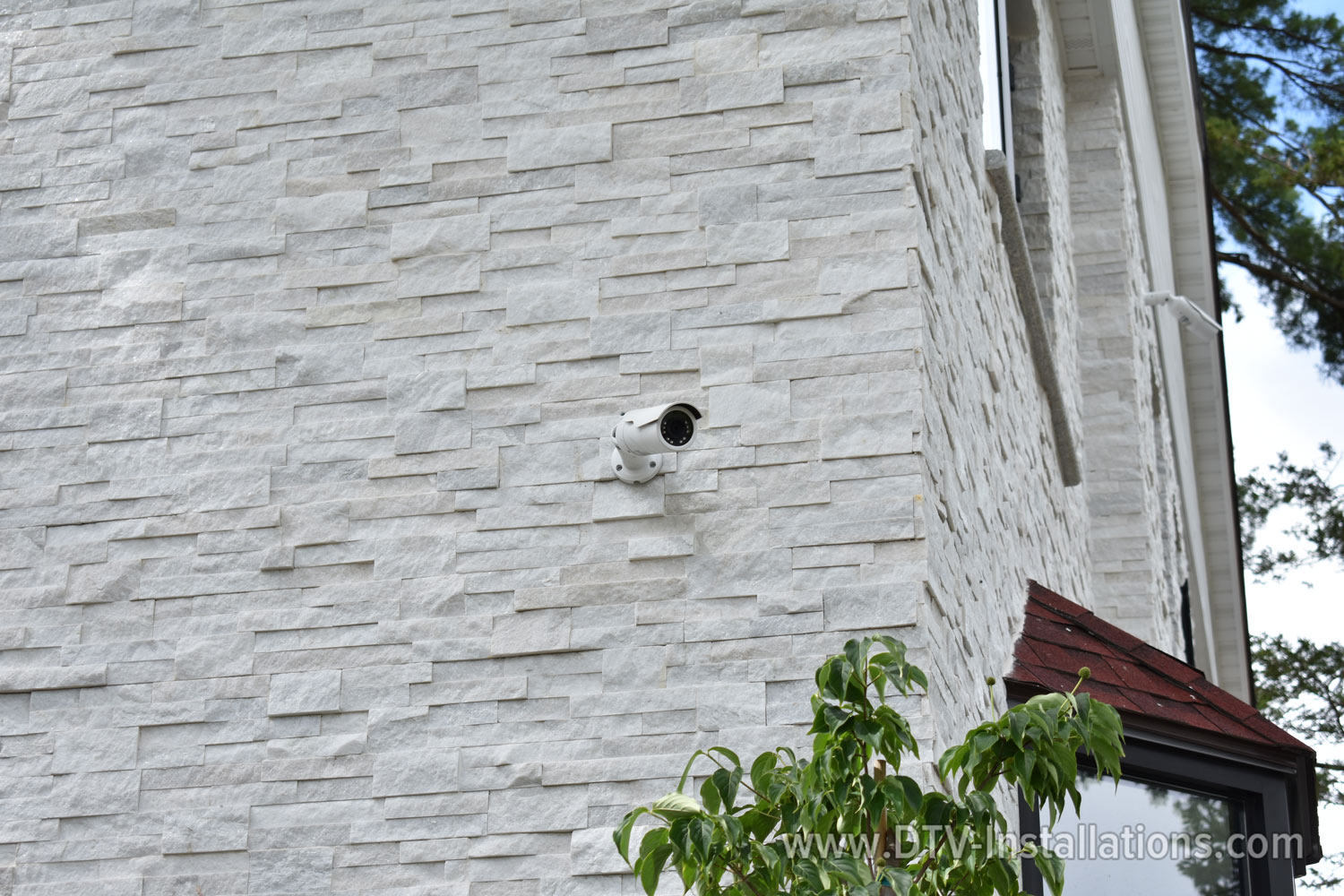 wired 4k outdoor security camera on church wall